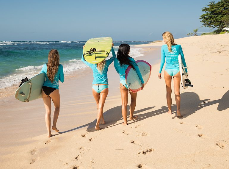 learning to surf, sunset yoga, healthy meals and day trips to local sites
